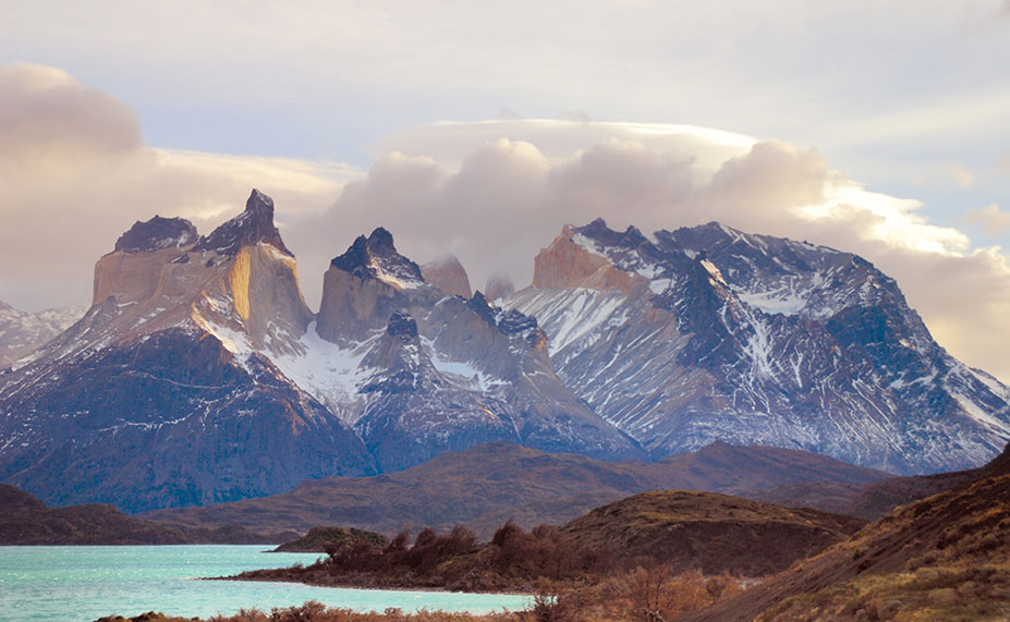 The characteristic layers of sedimentary rock that forms Cuernos del Paine seen from Lake Pehoe